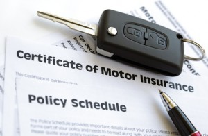 Certificate of motor insurance and policy schedule with car key